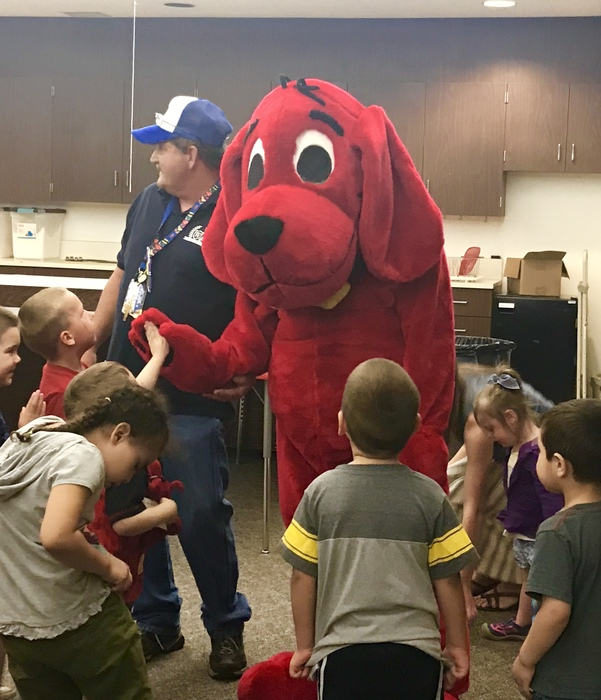 Clifford The Big Red Dog with students