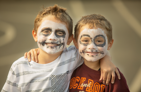 Two friends with faces painted at Fall Festival