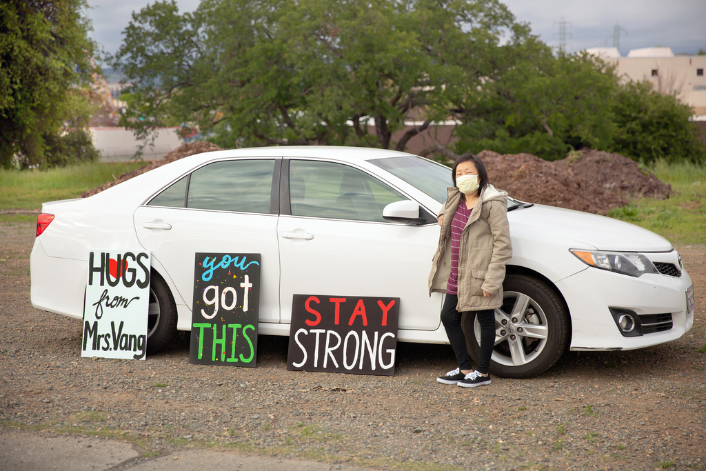 Teacher with signs on car