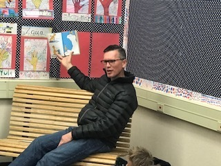Mr. Dowell practicing his read-aloud skills at Wyandotte Acadaemy.