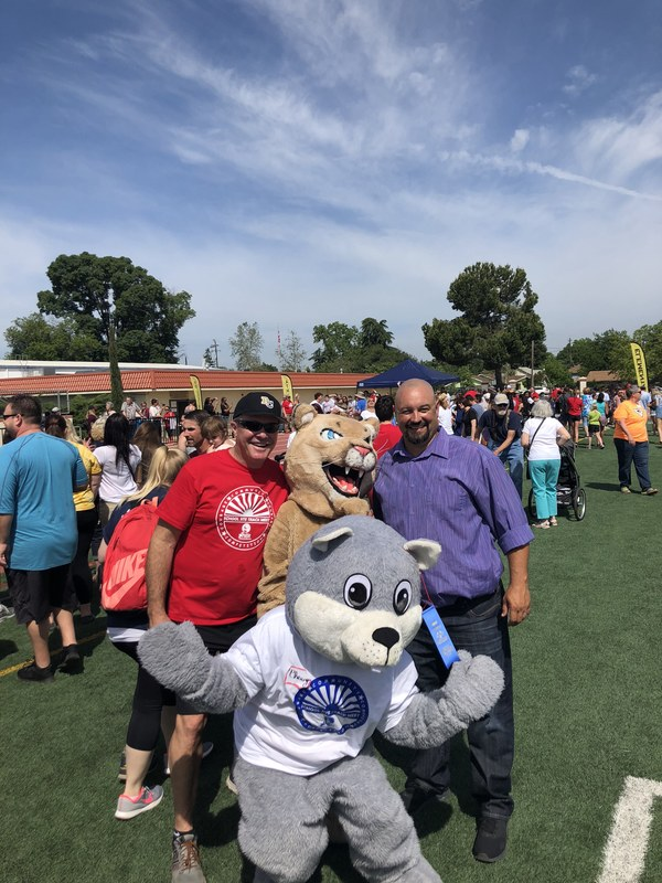 County Superintendent Tim Taylor, Ishi Hills Cougar, Principal Chris Renzullo and Chewy the Squirrel
